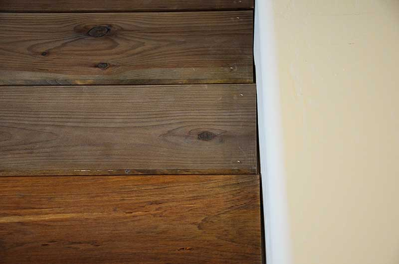 wood planking not flush with wall